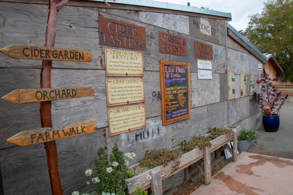 Finneriver Farm building with signs and menu